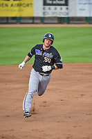 Luke Lowery (50) of the Missoula Osprey rounds the bases after hitting a home against the Ogden Raptors in Pioneer League action at Lindquist Field on July 20, 2015 in Ogden, Utah. Missoula defeated Ogden 10-6. (Stephen Smith/Four Seam Images)
