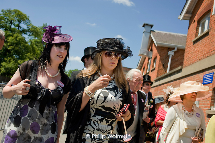 Racegoers approach the Royal Enclosure at Ascot racecourse on Ladies Day during Royal Ascot week..