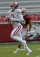Arkansas receiver Mike Woods makes a catch Saturday, April 3, 2021, ahead of defensive back Khari Johnson during a scrimmage at Razorback Stadium in Fayetteville. Visit nwaonline.com/210404Daily/ for today's photo gallery. <br /> (NWA Democrat-Gazette/Andy Shupe)