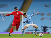 10th January 2021; Etihad Stadium, Manchester, Lancashire, England; English FA Cup Football, Manchester City versus Birmingham City; Phil Foden of Manchester City shields the ball from Maxime Colin of Birmingham City
