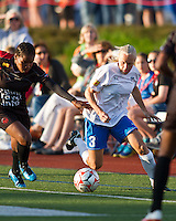Boston Breakers midfielder Tameka Butt (3) with FC Indiana midfielder Wisline Dolce (10) in pursuit.  The Boston Breakers beat FC Indiana 4-1 in their home opener at Dilboy Stadium