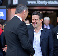 (L-R) Swansea manager Paul Clement greets Watford manager Marco Silva during the Premier League match between Swansea City and Watford at The Liberty Stadium, Swansea, Wales, UK. Saturday 23 September 2017