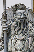 Bangkok, Thailand.  Chinese Guardian Statue outside Wat Pho (Reclining Buddha) Temple.