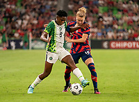 AUSTIN, TX - JUNE 16: Asisat Oshoala #8 of Nigeria fights for the ball with Emily Sonnett #14 of the USWNT during a game between Nigeria and USWNT at Q2 Stadium on June 16, 2021 in Austin, Texas.