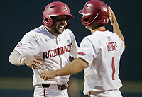 Arkansas catcher Casey Opitz (12) and infielder Robert Moore (1) embrace following a score, Monday, June 7, 2021 in the eighth inning of the NCAA Fayetteville Regional at Baum-Walker Stadium in Fayetteville. Check out nwaonline.com/210608Daily/ for today's photo gallery. <br /> (NWA Democrat-Gazette/Charlie Kaijo)