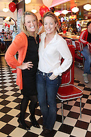 """NO REPRO FEE. 26/5/2011. NEW EDDIE ROCKET'S SHAKE SHOP. Jenny and Kate O Duffy are pictured in the new Eddie Rocket's Shake Shop. The design seeks to recall the vintage milkshake bars from 1950's America and re-imagine them for the 21st century. The new look aims to appeal to both young and old with a quirky and bold colour scheme and a concept of make-your-own milkshakes, based on the tag line """"You make it...We shake it!"""". Eddie Rocket's City Diner in the Stillorgan Shopping Centre in south Dublin has re-opened after an exciting re-vamp and the addition of a Shake Shop. Ten new jobs have been created with the Diner's re-launch bringing the total working in Eddie Rocket's Stillorgan to 30. Picture James Horan/Collins Photos"""