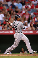 Seattle Mariners outfielder Greg Halman #56 bats against the Los Angeles Angels at Angel Stadium on July 9, 2011 in Anaheim,California. (Larry Goren/Four Seam Images)