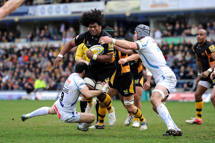Ashley Johnson of London Wasps is tackled by Haydn Thomas (left) and Richard Baxter of Exeter Chiefs during the Aviva Premiership match between London Wasps and Exeter Chiefs at Adams Park on Sunday 21st April 2013 (Photo by Rob Munro)