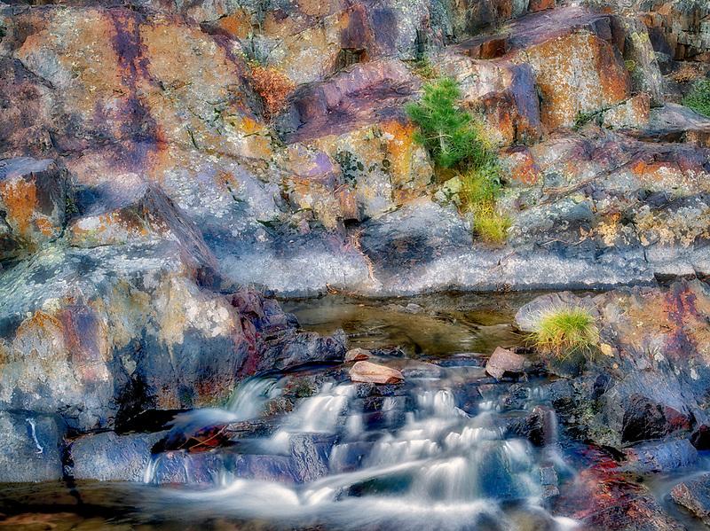 Small waterfal with lichen covered rocks on Glen Alpine Creek near Fallen Leaf Lake. California