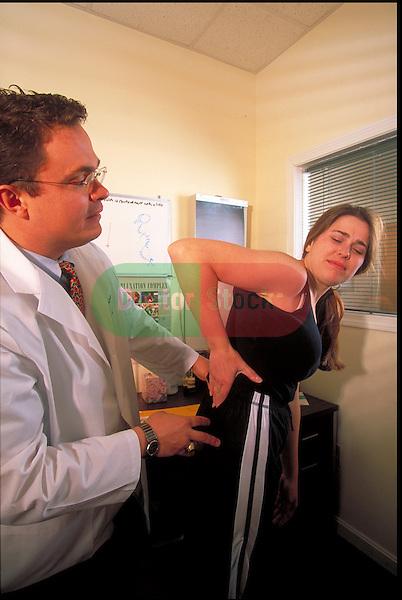 patient describing pain to chiropractor