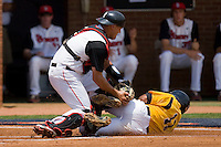Joe Witkowski #9 of the St. John's Red Storm puts the tag on Richard Gonzalez #11 of the VCU Rams at the Charlottesville Regional of the 2010 College World Series at Davenport Field on June 5, 2010, in Charlottesville, Virginia.  The Red Storm defeated the Rams 8-6.  Photo by Brian Westerholt / Four Seam Images