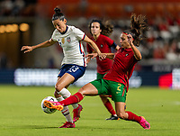 HOUSTON, TX - JUNE 10: Christen Press #23 of the USWNT is defended by Catarina Amado #2 of Portugal during a game between Portugal and USWNT at BBVA Stadium on June 10, 2021 in Houston, Texas.