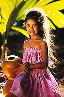 Keiki Auwana hula dancer Gabrielle with an Ipu Heke, (gourd-implement) in Wahiawa, central Oahu