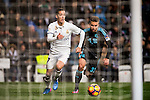 Lucas Vazquez (l) of Real Madrid competes for the ball with Kevin Rodrigues of Real Sociedad during their La Liga match between Real Madrid and Real Sociedad at the Santiago Bernabeu Stadium on 29 January 2017 in Madrid, Spain. Photo by Diego Gonzalez Souto / Power Sport Images