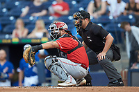 Louisville Bats catcher Juan Graterol (3) catches a pitch as home plate umpire John Mang looks on during the game against the Durham Bulls at Durham Bulls Athletic Park on May 28, 2019 in Durham, North Carolina. The Bulls defeated the Bats 18-3. (Brian Westerholt/Four Seam Images)