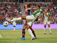 AUSTIN, TX - JUNE 16: Alex Morgan #13 of the USWNT fights for the ball with Akudo Ogbonna #19 of Nigeria during a game between Nigeria and USWNT at Q2 Stadium on June 16, 2021 in Austin, Texas.