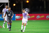 LAKE BUENA VISTA, FL - AUGUST 06: Oriol Rosell #20 of Orlando City SC kicks the ball during a game between Orlando City SC and Minnesota United FC at ESPN Wide World of Sports on August 06, 2020 in Lake Buena Vista, Florida.