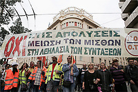 Pictured: Protesters with banners and flags on the streets of central Athens, Greece. Wednesday 17 May 2017<br /> Re: Clashes between anti fourth memorandum protesters and riot police during 24 hour strike in Athens, Greece