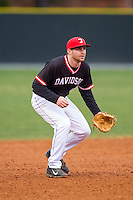 Davidson Wildcats third baseman David Daniels (8) on defense against the Wake Forest Demon Deacons at Wilson Field on March 19, 2014 in Davidson, North Carolina.  The Wildcats defeated the Demon Deacons 7-6.  (Brian Westerholt/Four Seam Images)
