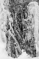 Black and white image of ice cascading down granite walls.