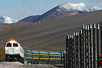 This is the Kunlun Pass of Tibet Railway in Qinghai province, China. A Lhasa-bound train tops the 4,767m Kunlun Pass, one of the highest points on the Lhasa railway.The metal poles on the side of the track conduct heat from the permafrost in a bid to ensure the soil remains frozen all year round. Reaching 5,072m above sea level, the railway is the world's highest..08 Jul 2006