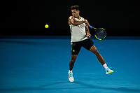 11th February 2021, Melbourne, Victoria, Australia; Michael Mmoh of the United States of America returns the ball during round 2 of the 2021 Australian Open on February 11 2020, at Melbourne Park in Melbourne, Australia.