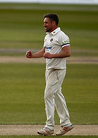15th April 2021; Emirates Old Trafford, Manchester, Lancashire, England; English County Cricket, Lancashire versus Northants; Former Lancashire spinner Simon Kerrigan celebrates after he takes the wicket of Dane Villas lbw for26