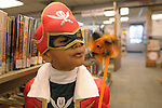 Sujwal Yedunuthula, 3, plays with a pinwheel at the Carson City Library Monday, Oct. 27, 2014. As part of the library's Halloween festivities, dozens of children decorated pumpkins or gourds and took part in a costume contest.