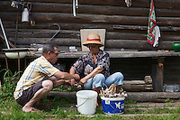 Korovikha, Ivanova Region, Russia, 05/08/2012..Pensioners Luba and  Leonid Gorbach prepare garlic grown in the garden of their  home in the village of Korovikha, some 200 miles east of Moscow.