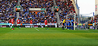 Tuesday, 7 May 2013<br /> <br /> Pictured: Jonathan de Guzman of Swansea City  (20) prepares to take a shot from inside the Wigan box while the referee is arranging the Wigan wall.<br /> <br /> Re: Barclays Premier League Wigan Athletic v Swansea City FC  at the DW Stadium, Wigan