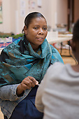 Local residents speak to a Housing Advice and Support worker at a regular Monday afternoon drop-in session at the Beethoven Centre, Queen's Park.