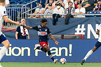 FOXBOROUGH, MA - AUGUST 18: DeJuan Jones #24 of New England Revolution passes the ball during a game between D.C. United and New England Revolution at Gillette Stadium on August 18, 2021 in Foxborough, Massachusetts.
