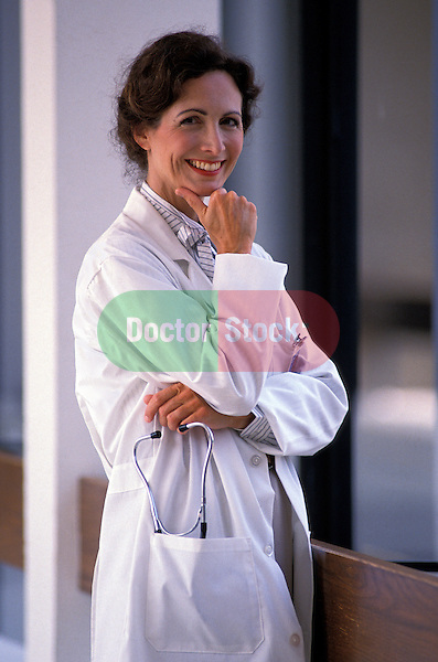 portrait of smiling woman doctor in hospital corridor