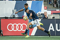 FOXBOROUGH, MA - SEPTEMBER 29: Alexander Callens #6 of New York City FC battle for a head ball with Gustavo Bao #7 of New England Revolution during a game between New York City FC and New England Revolution at Gillettes Stadium on September 29, 2019 in Foxborough, Massachusetts.