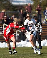 Boston College attacker Covie Stanwick (8) on the attack as Boston University attacker Nell Burdis (16) defends..Boston College (white) defeated Boston University (red), 12-9, on the Newton Campus Lacrosse Field at Boston College, on March 20, 2013.