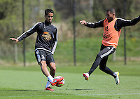 (L-R) Kyle Naughton and Kenji Gorre during the Swansea City FC training at Fairwood, Swansea, Wales, UK on Wednesday 04 May 2016
