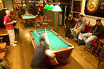 Patrons shoot pool in the back room at Kochevar's in Crested Butte, CO.  © Michael Brands.