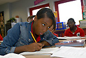 Dr. Martin Luther King Charter School for Science and Technology eighth-grader Shaniece Smith takes notes during language arts, New Orleans, Tuesday, Oct. 16, 2007.<br />(Cheryl Gerber photo)