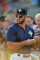 Left fielder Tim Tebow (15) of the Columbia Fireflies signs an autograph before a game against the Lexington Legends on Friday, April 21, 2017, at Spirit Communications Park in Columbia, South Carolina. Tebow went 3-for-3 with a walk and Columbia won, 5-0. (Tom Priddy/Four Seam Images)