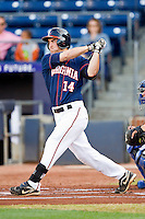 Colin Harrington #14 of the Virginia Cavaliers follows through on his swing against the Duke Blue Devils at Durham Bulls Athletic Park on April 20, 2012 in Durham, North Carolina.  The Blue Devils defeated the Cavaliers 6-3.  (Brian Westerholt/Four Seam Images)