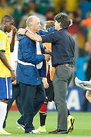 Brazil head coach Luiz Felipe Scolari hugs Germany manager Joachim Low