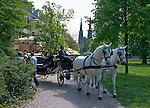 Germany, Baden-Wuerttemberg, Baden-Baden: Enjoy a ride through the picturesque gardens of Lichtentaler Allee in a horse-drawn carriage | Deutschland, Baden-Wuerttemberg, Baden-Baden: mit dem Fiaker durch die Parkanlagen der Lichtentaler Allee