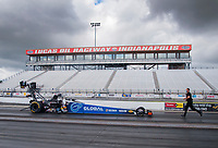 Jul 10, 2020; Clermont, Indiana, USA; NHRA top fuel driver Tony Schumacher is backed up by a crew member after his burnout during testing for the Lucas Oil Nationals at Lucas Oil Raceway. This will be the first race back for NHRA since the COVID-19 pandemic. Mandatory Credit: Mark J. Rebilas-USA TODAY Sports