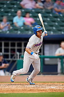 Midland RockHounds shortstop Richie Martin (12) follows through on a swing during a game against the Northwest Arkansas Naturals on May 27, 2017 at Arvest Ballpark in Springdale, Arkansas.  NW Arkansas defeated Midland 3-2.  (Mike Janes/Four Seam Images)