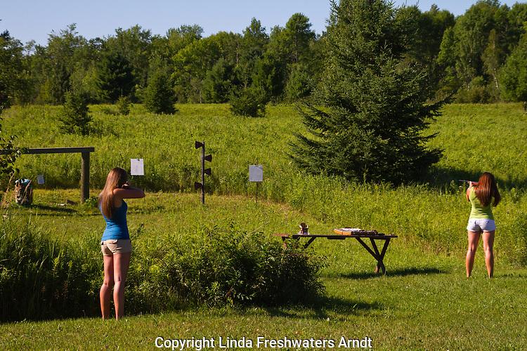 Young women shooting rifles