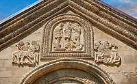 Pictures & images of Nikortsminda ( Nicortsminda ) St Nicholas Georgian Orthodox Cathedral exterior and its Georgian relief sculpture stonework depicting saints an St George slaying the dragon, 11th century, Nikortsminda, Racha region of Georgia (country). A UNESCO World Heritage Tentative Site.