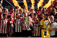 29th May 2021; Wembley Stadium, London, England; English Football League Championship Football, Playoff Final, Brentford FC versus Swansea City; Pontus Jansson of Brentford lifting the Sky Bet EFL Championship Plays-off Trophy with his team mates after they won 2-0 and promoted to the premier league