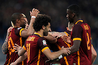 Calcio, Serie A: Roma vs Fiorentina. Roma, stadio Olimpico, 4 marzo 2016.<br /> Roma's Mohamed Salah, center, celebrates with teammates after scoring during the Italian Serie A football match between Roma and Fiorentina at Rome's Olympic stadium, 4 March 2016.<br /> UPDATE IMAGES PRESS/Riccardo De Luca