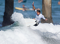 Huntington Beach, CA - Tuesday July 31, 2018: Thiago Camarao in action during a World Surf League (WSL) Qualifying Series (QS) Men's round of 96 heat at the 2018 Vans U.S. Open of Surfing on South side of the Huntington Beach pier.