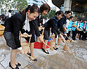 Tokyo Governor Koike attends water sprinkling event at Tokyo Midtown Hibiya in the midst of heatwave